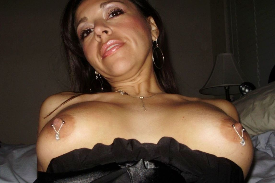 Curvy MILF shows her hot pierced nipples and very sexy body. Naughty MILF are proud of their pierced nipples on erotic picture